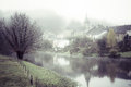 Mist at semois river desaturated image of morning hanging over the chassepierre village in the gaume region of the belgian Stock Images