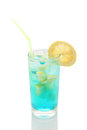 Misted glass of lemonade with lemon and blue syrup on a white background isolate Royalty Free Stock Photo