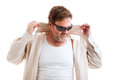 Mister cool middle aged man in sunglasses and shirt with turned up collar trying to be isolated on white Stock Image