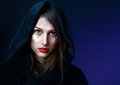 Misteriouse woman in black hood Stock Images