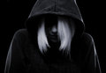 Mistery girl hiding her face under the hood misterious with isolated on black background Stock Images