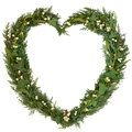 Mistletoe heart wreath christmas shaped floral with ivy and cedar leaf sprigs over white background Royalty Free Stock Image