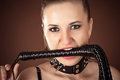 Mistress with a whip in the mouth portrait of Royalty Free Stock Images