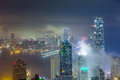 Misty city and Skyscraper in fog at night Royalty Free Stock Photo