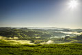Misty hills in Tuscany at sunrise Stock Photos