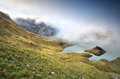 Misty morning on alpine lake Schrecksee Royalty Free Stock Photo