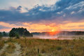 Misty summer sunrise. Foggy river in the morning. Misty morning Royalty Free Stock Photo