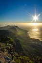 Misty sun set a sunset on top of table mountain in south africa Stock Photography