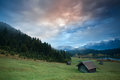 Misty sunrise over huts by geroldsee lake in bavarian alps germany Stock Photos