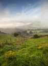 Misty yorkshire dales valley in autumn a view over a from an elevated position on a day Royalty Free Stock Photography