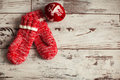 Mitten on wood floor with christmas ball winter decoration Royalty Free Stock Photography