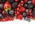 Mix berries on a white background. Berries and fruits with copy space for text. Black-blue and red food. Ripe blackberries, bluebe Royalty Free Stock Photo