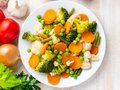 Mix of boiled vegetables, steam vegetables for dietary low-calorie diet. Broccoli, carrots, cauliflower, top view Royalty Free Stock Photo