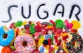 Mix of candies donuts and sugar in writing Royalty Free Stock Photo