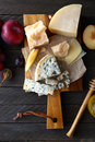 Mix cheeses on cutting board food top view Stock Image