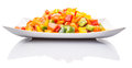 Mix colorful chopped capsicums in white plate iv a over background Stock Photography