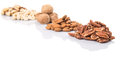 Mix culinary nuts ii over white background Royalty Free Stock Images