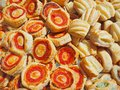 Mix of delicious appetizers and small pizzas made of puff pastry Royalty Free Stock Photo