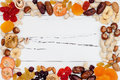 Mix of dried fruits and nuts on a white vintage wood background with copy space. Top view. Symbols of judaic holiday Tu Bishvat. Royalty Free Stock Photo