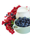 Mix of fresh berries with milk isolated on white background Royalty Free Stock Photo