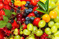 Mix of fresh fruits and berries raw food ingredients nutrition background Stock Photos
