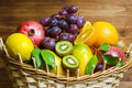 Mix of fresh fruits on wicker bascket Royalty Free Stock Photo