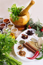 Mix of fresh herbs spices and oil on the table Royalty Free Stock Photos