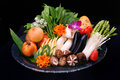 Mix fresh vegetables for grill in blue plate on black background Stock Photography