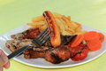 Mix grill steak include drumstick bacon pork beef sausage and vegetable with french fries Royalty Free Stock Photo