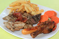 Mix grill steak include drumstick bacon pork beef sausage and vegetable with french fries Stock Photos