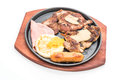 mix grilled steak on hot plate