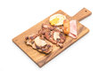 mix grilled steak on wood plate