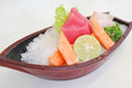 Mix of Japanese sashimi served in a plastic boat Royalty Free Stock Photography