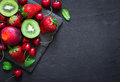 Mix of Juicy summer fruits and berries. Strawberry, cherry, kiwi Royalty Free Stock Photo