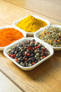 Mix of spices different in bowls with black pepper in focus Stock Photo