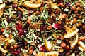 Mix tea karkade with dried fruits and flowers. Fruit tea background and texture. Top view. Food background. Organic