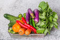 Mix tropical vegetables v in a container on a kitchen granite surface counter Royalty Free Stock Photo