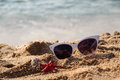 Mix of vivid starfishes on the beach and female sunglasses empty Stock Photos
