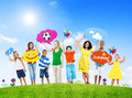 Mixed age people holding colorful speech bubbles group of in a summer concept photo Stock Photo