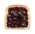 Mixed berries preserves on bread aerial view of spread over a slice of white this jam contains strawberries blackberries Stock Photos