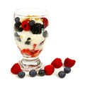 Mixed berry granola and yogurt parfait healthy over a white background Stock Images