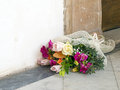 Mixed bouquet by doorway jilted bride maybe beautiful flowers outside church on the ground Stock Photo