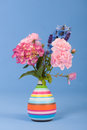 Mixed bouquet flowers on blue background Royalty Free Stock Photo