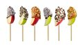 Mixed candy dipped apple slices isolated on white Royalty Free Stock Photo