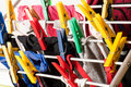 Mixed clean laundry pinned with colourful clothespins on white background Royalty Free Stock Photos