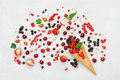 Mixed colorful berries in waffle cone on white table top view in flat lay style. Royalty Free Stock Photo