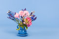 Mixed colorful bouquet on blue background Royalty Free Stock Photo