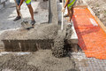 Mixed concrete pouring at construction site. Royalty Free Stock Photo