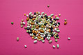 Mixed dried beans and peas on a pink background Royalty Free Stock Photo