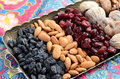 Mixed dried fruits and nuts in oriental style assorted on brass tray raisins almond cranberry figs walnut Stock Image